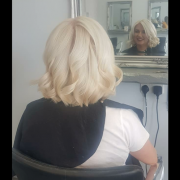 Hair dyed platinum blonde with curls