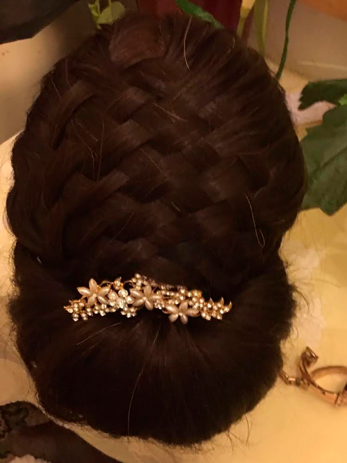Bridal hairdo plaited with jewellery in hair